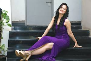 Urvashi Pardeshi looking very hot in purple dress